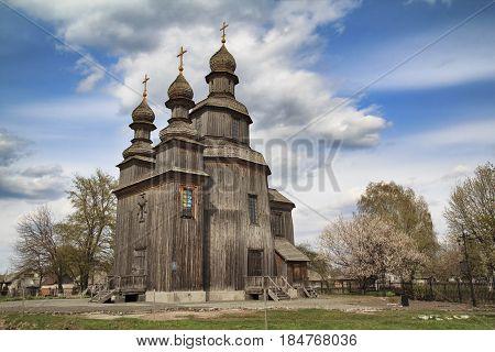 Dark ancient wooden church - St. George's shrine - described in Gogol's