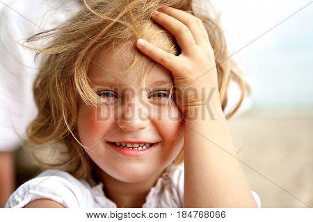 Smiling Little Blonde Girl