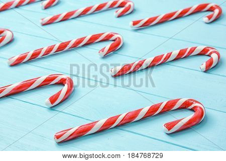 Christmas candy canes on blue background