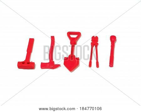 red toy plastic fire fighter equipment on white background