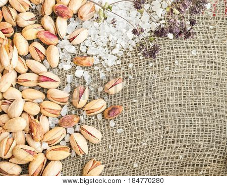 Pistachios In Shell And Peeled Pistachios With Salt And Dry Herbs