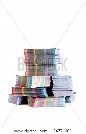 stacks of colorful printed materials on white background