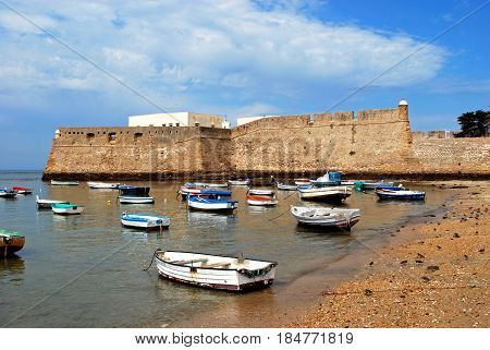 CADIZ, SPAIN - SEPTEMBER 8, 2008 - View of the castle with fishing boats moored in the foreground Cadiz Cadiz Province Andalusia Spain Western Europe, September 8, 2008.