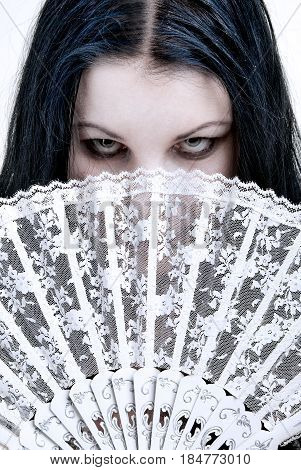 Woman Hidden Behind A Fan
