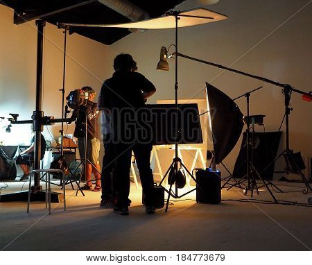 Silhouette Of People Working In Production Studio.