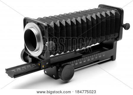 photo equipment - old black macro bellows on white background