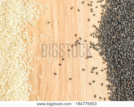 Black And White Sesame Seeds On Wooden Background With Space For Text