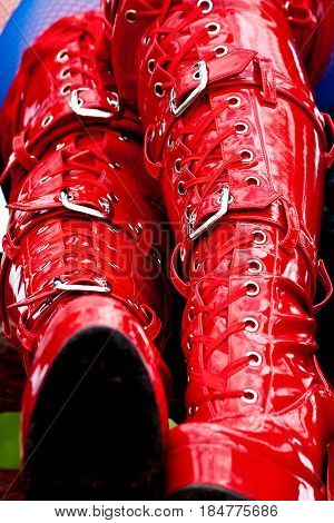 red latex fetish kinky boots with some metal buckles