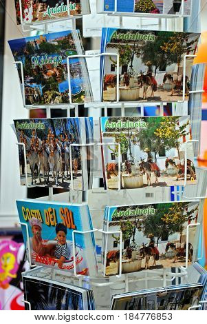 TORREMOLINOS, SPAIN - SEPTEMBER 3, 2008 - Postcards for sale in a rack outside a tourist shop Torremolinos Malaga Province Andalusia Spain Western Europe, September 3, 2008.