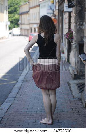 girl in skirt posing on the street