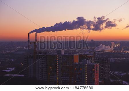 Two Industrial Tubes, Sunrise City View, Pink Warm Sky.