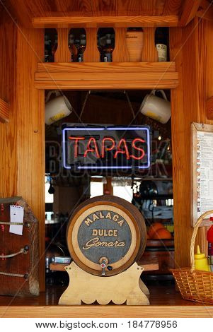 TORREMOLINOS, SPAIN - SEPTEMBER 3, 2008 - Tapas sign and a Malaga sweet wine barrel at a beach bar Torremolinos Malaga Province Andalusia Spain Western Europe, September 3, 2008.