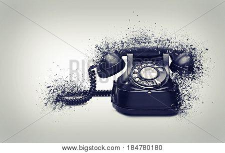 Old and vintage telephone shattered on gradiant background