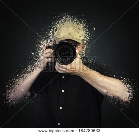 Men's hands held camera shattered on black