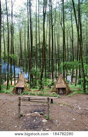 traditional tent in the pine forest at tawangmangu, indonesia