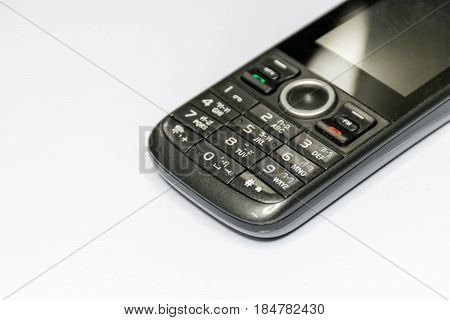 Old mobile phone isolated on White background