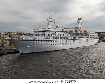 ST. PETERSBURG, RUSSIA - MAY 1, 2017: Cruise liner Astor moored at English embankment. The ship owned by British Cruise & Maritime Voyages was built in 1987 and extensively refurbished in 2010