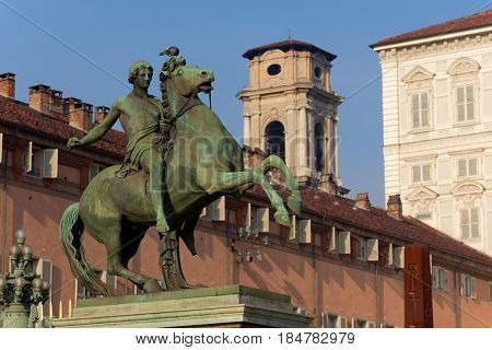 TURIN, ITALY - JANUARY 11, 2013: Equestrian statue of Castor in front of the Royal Palace. The statue was created in 1847 by design of Abbondio Sangiorgio