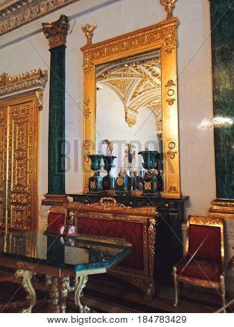 Golden room in the State Hermitage Museum or the Winter Palace, a former residence of Russian emperors in Saint Petersburg, Russia - July 2016