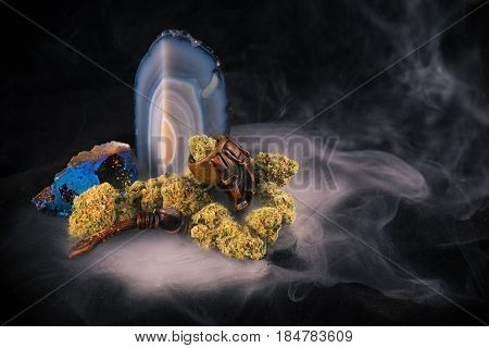 Detail of cannabis buds (Zed strain) isolated over black background with smoke - medical marijuana concept