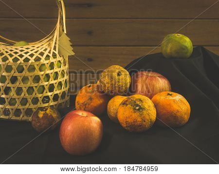 Still life with group of rotten and fresh fruits