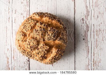 Fresh Seedy Bread On White Wooden Background