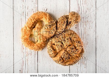 Fresh Seedy Breads On White Wooden Background