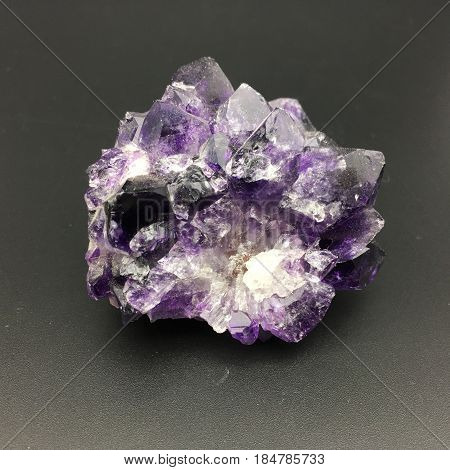 a purple amethyst with multiple spires, broken from a larger piece