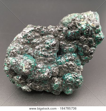 a weird greenish metal rock with a bubbled texture
