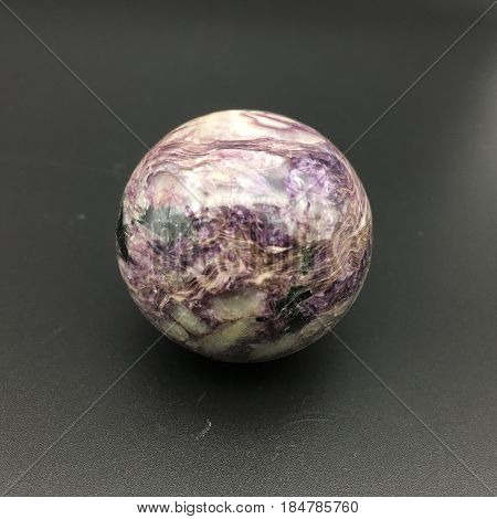 purpurite stone that had been shaped into a perfect orb