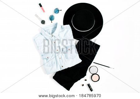 Beauty blog concept. Woman clothes and accessories: hat jeans t-shirt watches sunglasses sneakers on white background. Flat lay top view trendy fashion feminine background.