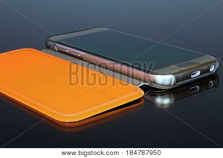 Mobile phone in case. Mirroring the gold mobile phone in orange case.