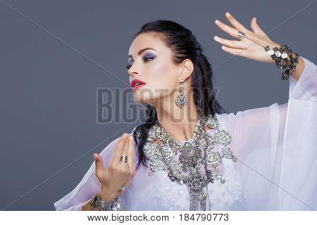 Sexy arabic belly dancer woman dancing portrait