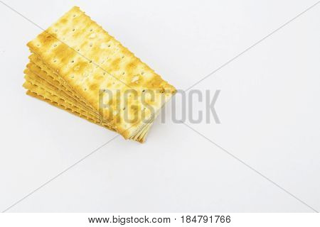 Stack of graham sweet savoury crackers on a white background