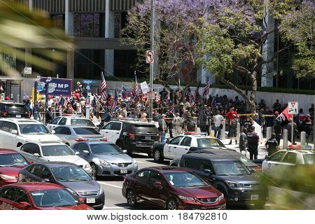 LOS ANGELES California- May 1, 2017: People Wave Signs, Wear Costumes, Yell, Argue, and Demand Change at a Protest Rally Against President Donald J.Trump on May 1, 2017 in Los Angeles, California