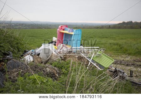 Waste dumped in the countryside in the countryside an illegal social issue fly tipping causing environmental pollution