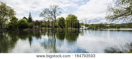 SWINDON UK - MAY 1 2017: Boat on the River Thames at Mapledurham Lock near Reading Berkshire