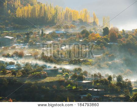 Altit Village With Surrounding Mist In Hunza Valley, Karimabad, Gilgit-Baltistan Region Of Pakistan