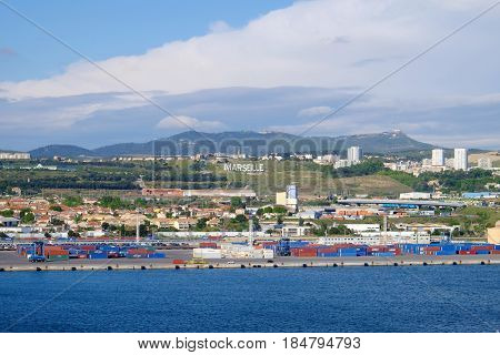 MARSEILLES FRANCE - APRIL 27 2017: View of the inscription in white letters Marcel on the hill and the port of Marseilles.