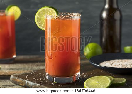 Homemade Michelada With Beer And Tomato Juice