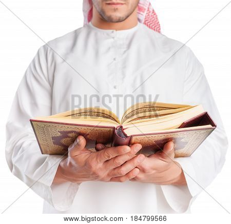 A senior cleric is portrayed with a book in his hands
