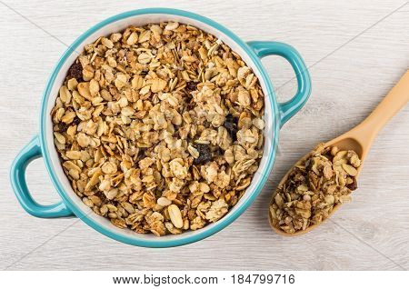 Muesli With Fruits And Nuts In Blue Bowl And Spoon