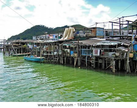 Houses built on stilts over the water in the fishing village Tai O on Lantau Island in Hong Kong