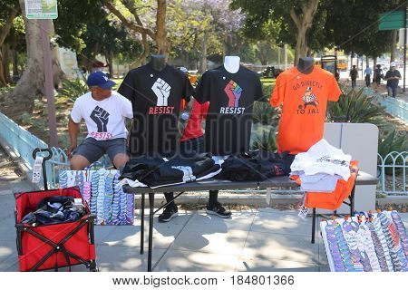 LOS ANGELES California- May 1, 2017:People sell T-Shirts, Buttons, Food, Propaganda, and stuff at a Protest Rally Against President Donald J. Trump on May 1, 2017 in Los Angeles, California