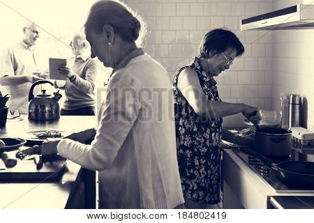 Senior Friends Cooking Food Kitchen