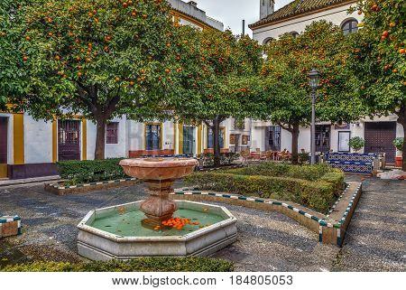 Small square with a fountain in the historic center of Seville Spain