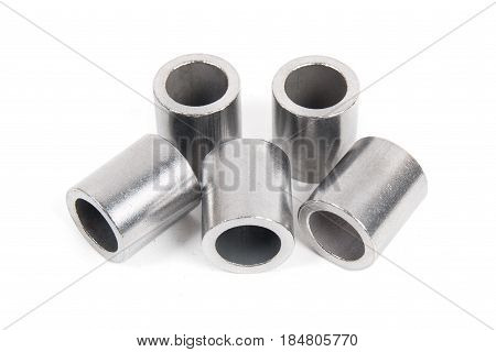 Metalworking technologies. Metal steel cylinders on a white background.