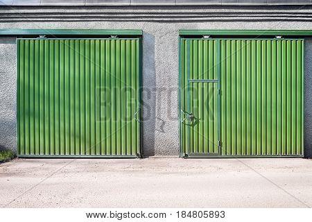 Metal green gates and door of the big storage.