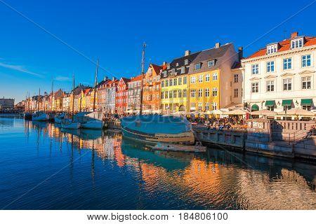 COPENHAGEN DENMARK - MARCH 11 2017: Copenhagen Nyhavn district. In 1977 Nyhavn was inaugurated as a veteran ship and museum harbour by Copenhagen Lord Mayor Egon Weidekamp