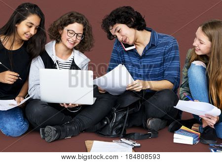 Group of Diverse Students Using Laptop Studio Portrait